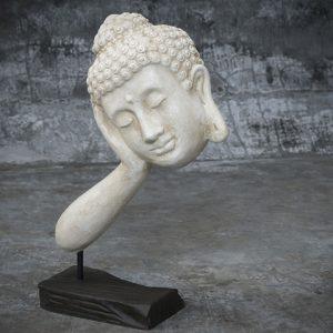 floating buddha head on stand