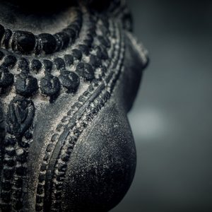hindu female torso on stand