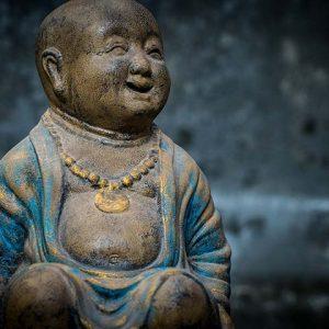 laughing buddha in bowl