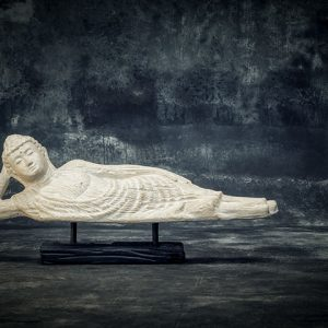 Sleeping Buddha on wooden stand
