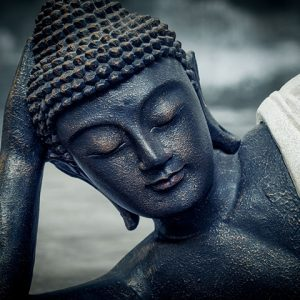 sleeping buddha in white robes
