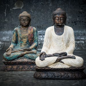 Sitting Buddha with opened hand on knee