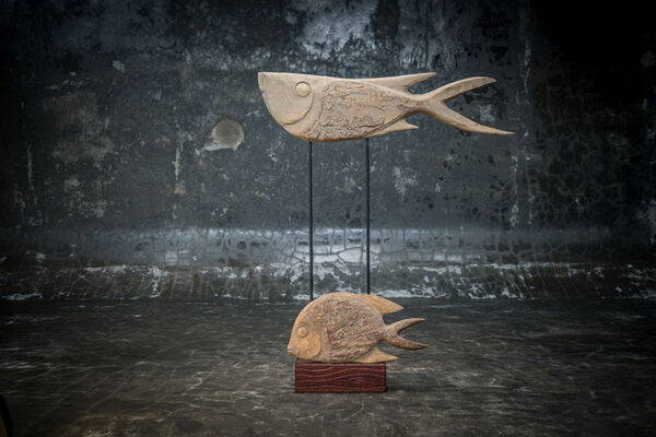 Wooden pair of fish on stand