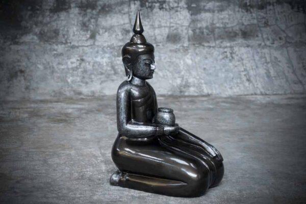 sitting Buddha holding bowl