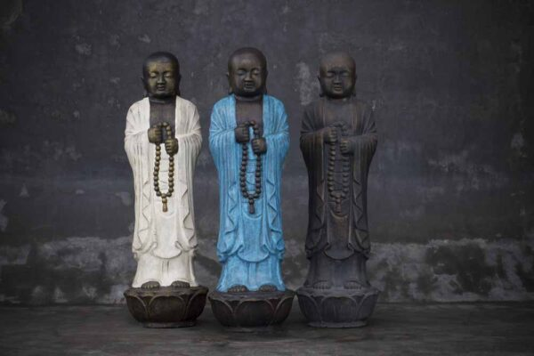 Buddha holding prayer chain