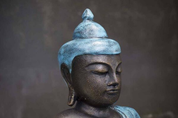 closed eyed Buddha with hand on the knee