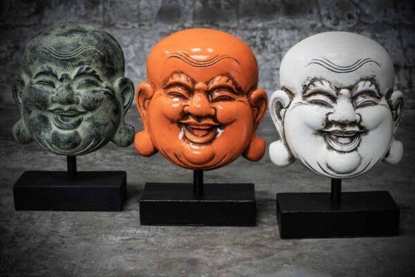 Laughing Buddha face on stand
