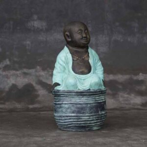 laughing little buddha sitting on bowl