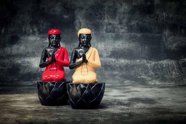 sitting buddha on pedestal