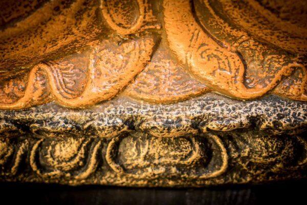 Crowned Buddha praying details base