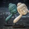Stonework products floating Buddha head Pair