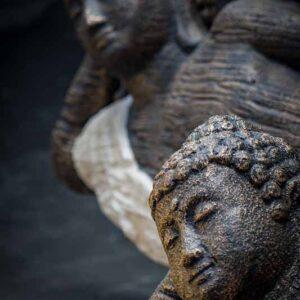 lying buddha closed eyed