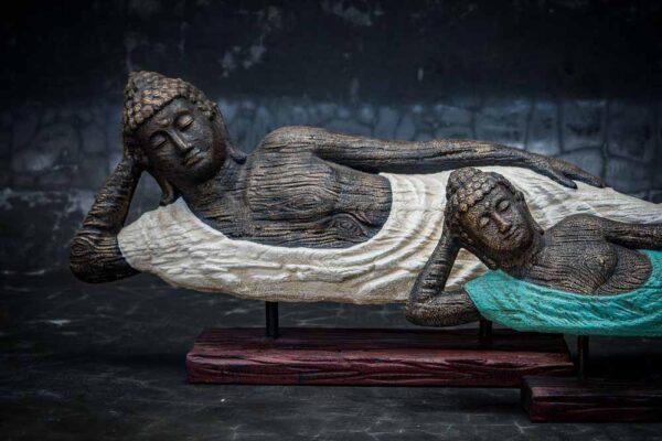 lying buddha closed eyed details body