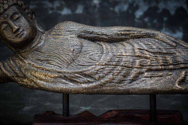 lying buddha closed eyed details chest