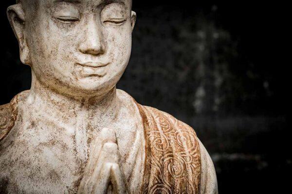 Monk praying details torso