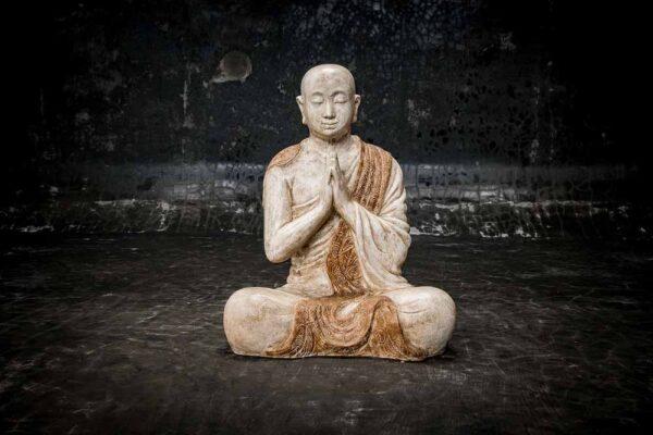 Monk praying details total view