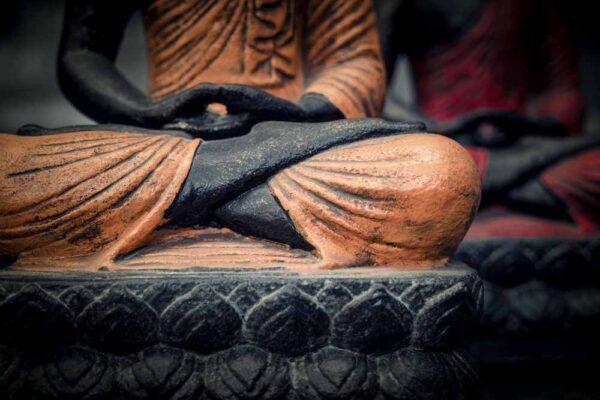 Sitting Buddha folded hands details hands