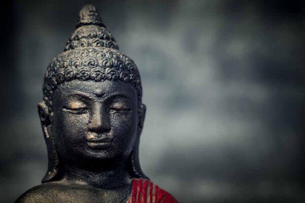 Sitting Buddha folded hands details orange red
