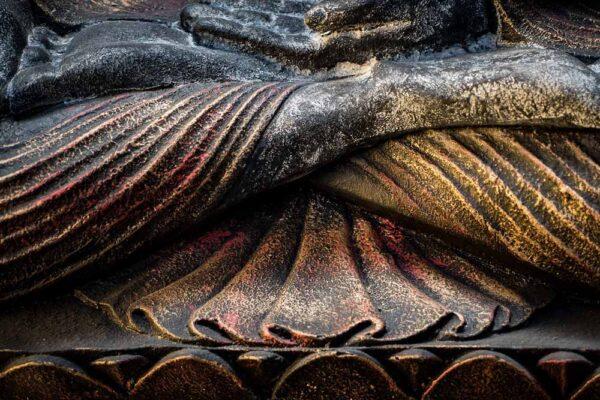 Sitting Buddha open hands details legs