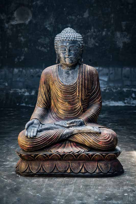 Sitting Buddha open hands on knee total view single