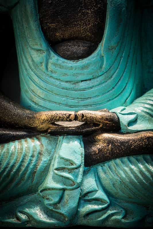 Meditating buddha details hands