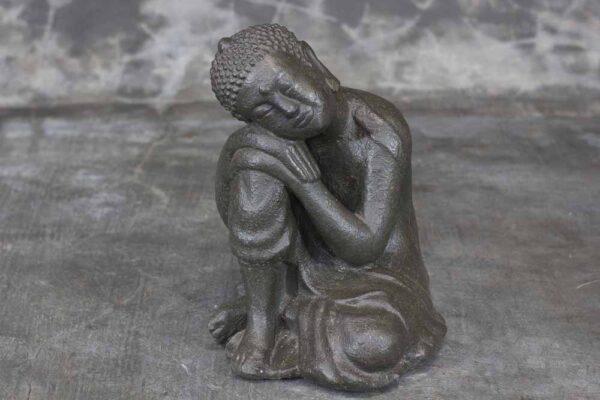 Buddha head resting on knee