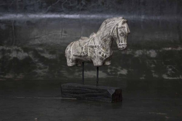 Horse on wooden stand