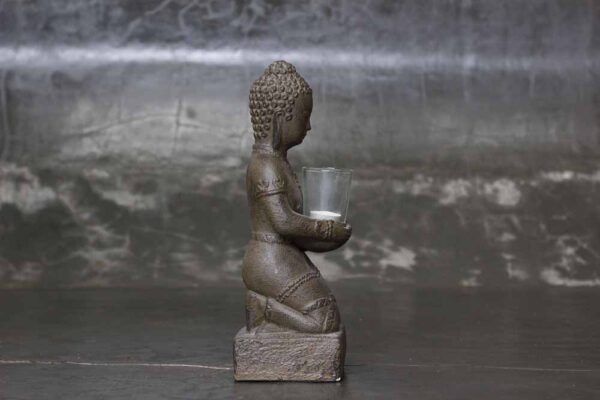 sitting Buddha on base with candle