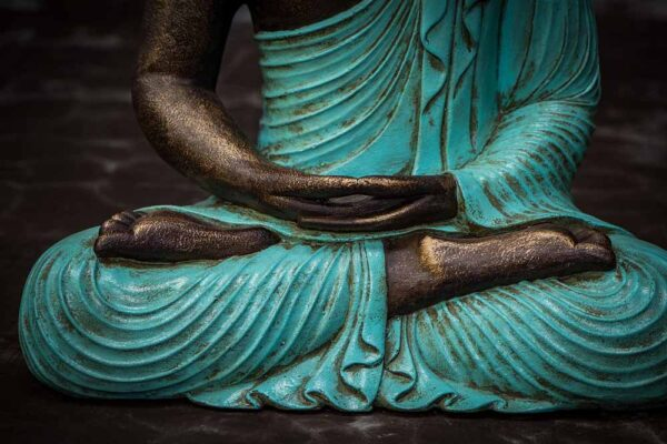 Closed eyed Buddha hands details turquoise