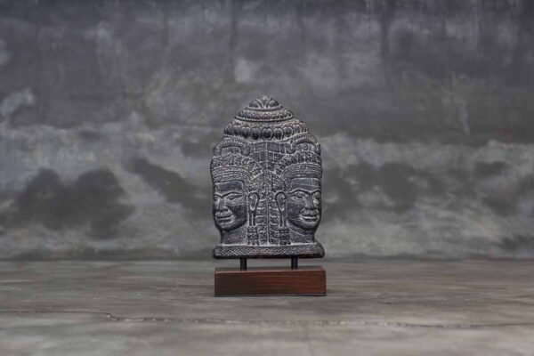 Two Buddha faces table relief